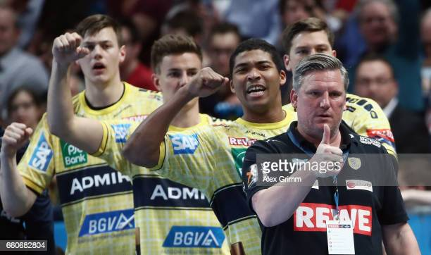 Head coach Nikolaj Jacobsen and players of RheinNeckar Loewen react during the EHF Champions League Quarter Final Leg 2 match between Rhein Neckar...