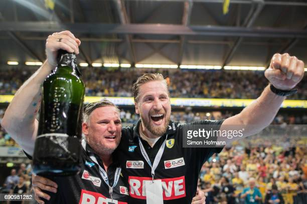 Head coach Nikolaj Jacobsen of RheinNeckar Loewen and Manager Oliver Roggisch celebrate after the DKB HBL match between RheinNeckar Loewen and THW...