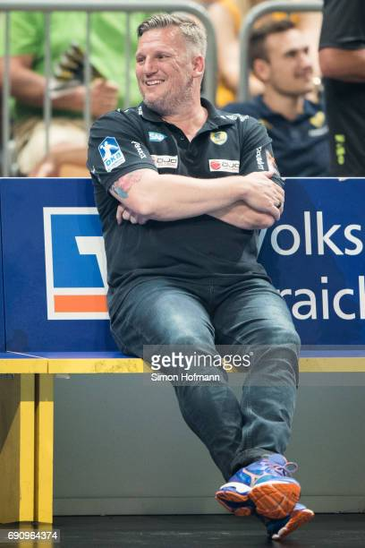 Head coach Nikolaj Jacobsen of RheinNeckar Loewen smiles as results of other matches are announced during the DKB HBL match between RheinNeckar...