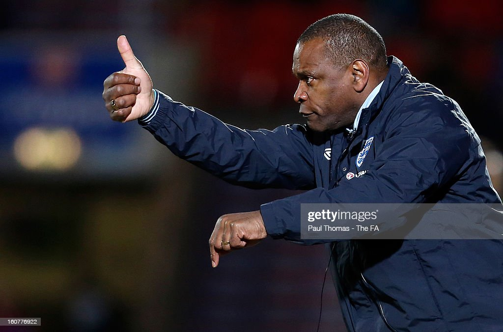 Head coach Noel Blake of England U19 gestures during the International U19 match between England and Scotland at the Keepmoat Stadium on February 5, 2013 in Doncaster, England.