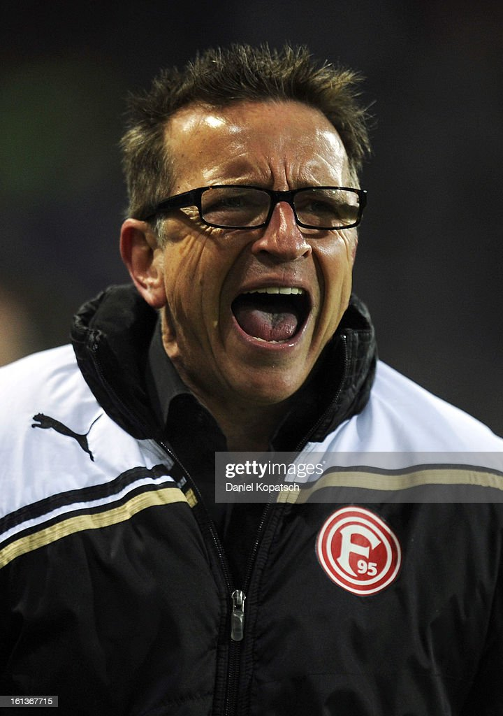 Head coach <a gi-track='captionPersonalityLinkClicked' href=/galleries/search?phrase=Norbert+Meier&family=editorial&specificpeople=811497 ng-click='$event.stopPropagation()'>Norbert Meier</a> of Duesseldorf reacts during the Bundesliga match between SC Freiburg and Fortuna Duesseldorf 1895 at MAGE SOLAR Stadium on February 10, 2013 in Freiburg im Breisgau, Germany.
