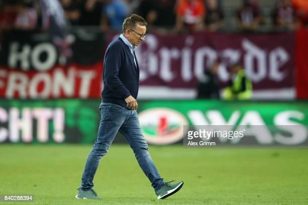 Head coach Norbert Meier of Kaiserslautern walks over the pitch after the Second Bundesliga match between 1 FC Kaiserslautern and Eintracht...