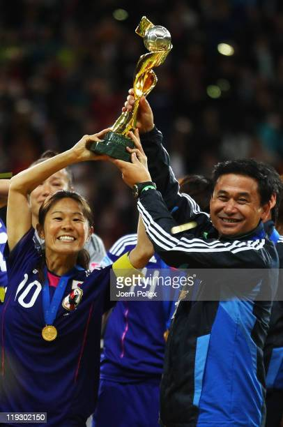 Head coach Norio Sasaki and Homare Sawa celebrates with the cup after winning the FIFA Women's World Cup Final match between Japan and USA at the...
