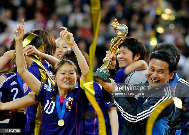 Head coach Norio Sasaki and Homare Sawa of Japan celebrates after defeating USA for the FIFA Women's World Cup Final match between Japan and USA at...