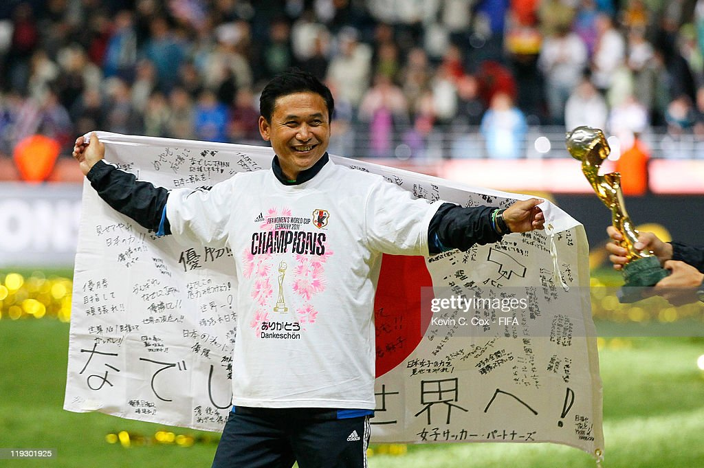 Head coach <a gi-track='captionPersonalityLinkClicked' href=/galleries/search?phrase=Norio+Sasaki+-+Soccer+Coach&family=editorial&specificpeople=5488586 ng-click='$event.stopPropagation()'>Norio Sasaki</a> of Japan celebrates after winning the FIFA Women's World Cup Final match between Japan and USA at the FIFA World Cup Stadium Frankfurt on July 17, 2011 in Frankfurt am Main, Germany.