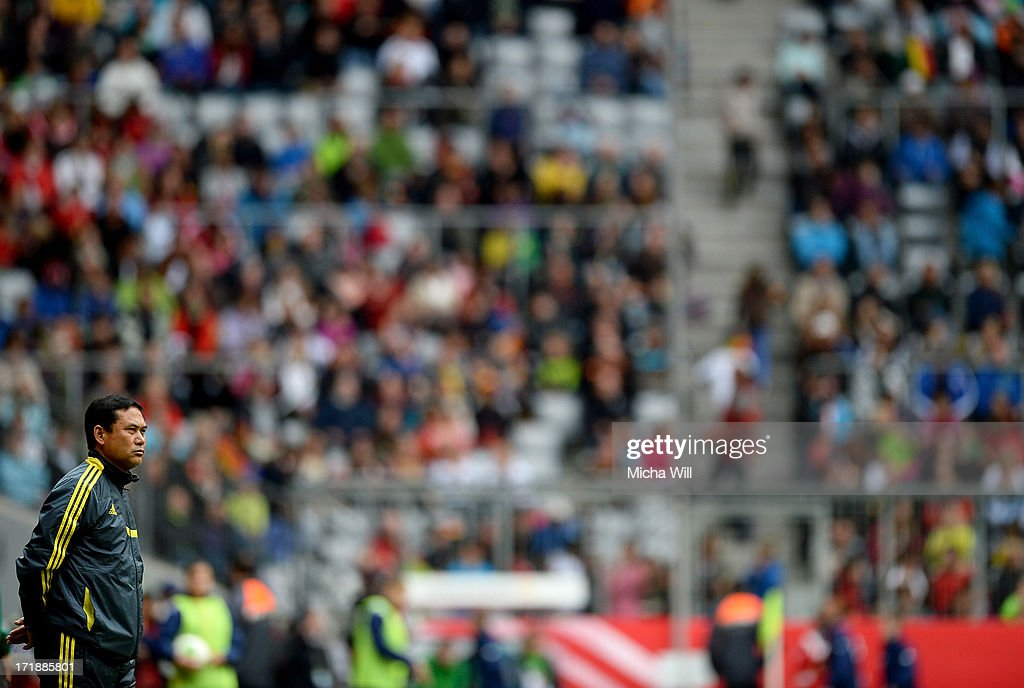 Head coach Norio Sasaki of Japan looks on during the Women's International Friendly match between Germany and Japan at Allianz Arena on June 29, 2013 in Munich, Germany.