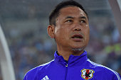 Head Coach Norio Sasaki of Japan sings the nationa anthem before the MSAD Nadeshiko Cup 2015 women's soccer international friendly match between...