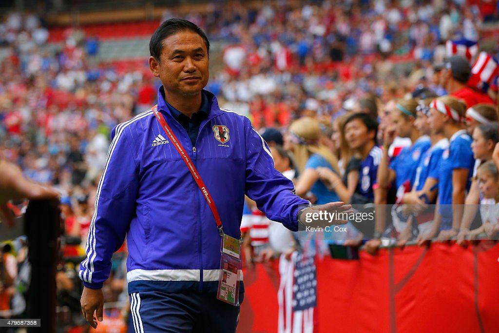 Head coach <a gi-track='captionPersonalityLinkClicked' href=/galleries/search?phrase=Norio+Sasaki+-+Soccer+Coach&family=editorial&specificpeople=5488586 ng-click='$event.stopPropagation()'>Norio Sasaki</a> of Japan walks out to the pitch to take on the United States in the FIFA Women's World Cup Canada 2015 Final at BC Place Stadium on July 5, 2015 in Vancouver, Canada.