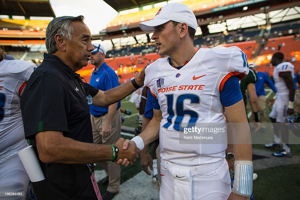 Head coach Norm Chow of the Hawaii Warriors shakes hands with Joe Southwick of the Boise State Broncos after the game on November 10 2012 at Aloha...