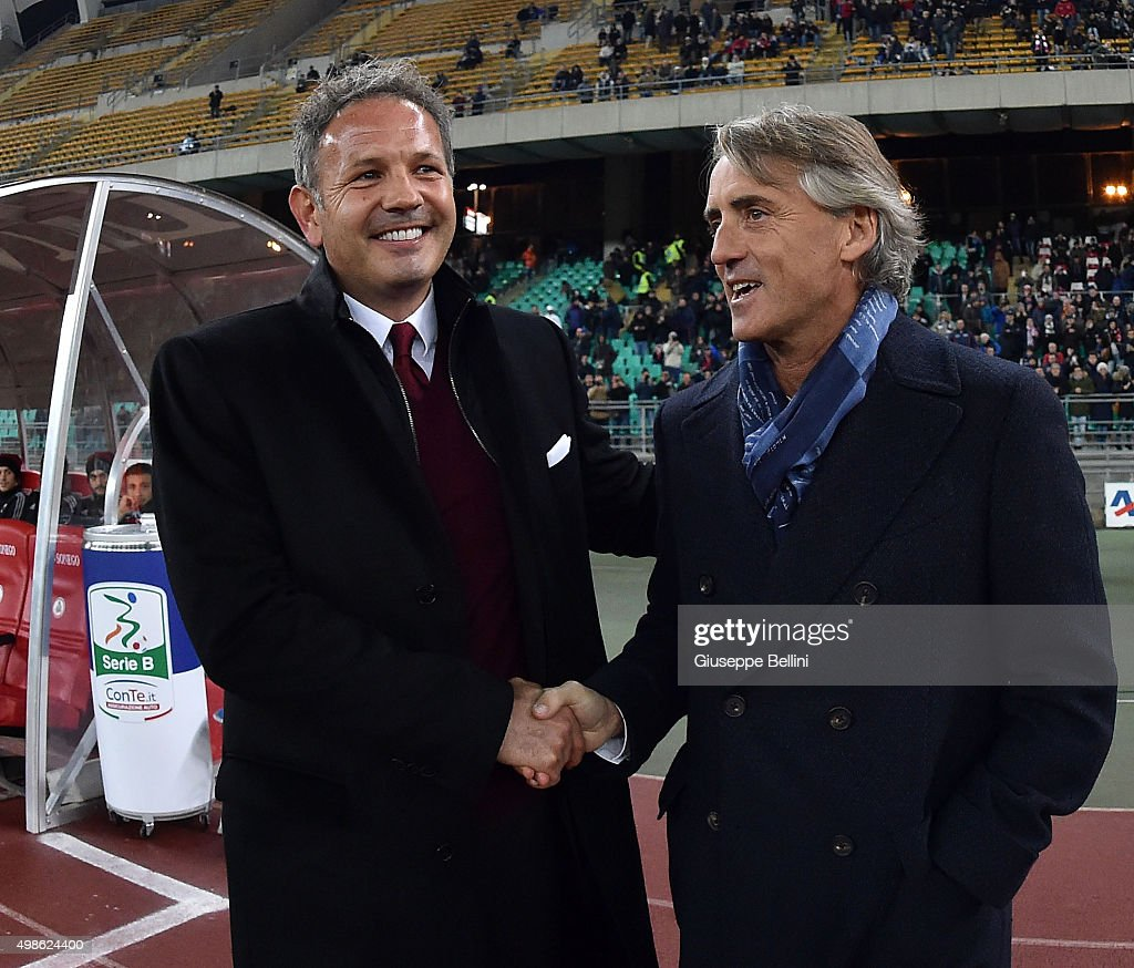 Head coach of AC Milan Sinisa Mihajlovic and head coach of FC Internazionale Roberto Mancini shake hands before a tournament between FC Internazionale, AC Milan and AS Bari at Stadio San Nicola on November 24, 2015 in Bari, Italy.