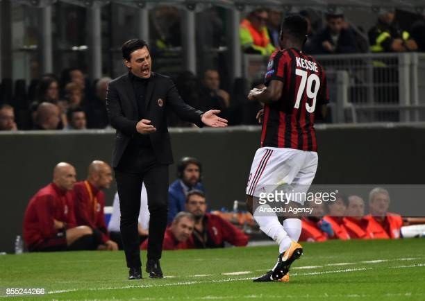 Head Coach of AC Milan Vincenzo Montella speaks with Franck Kessie of AC Milan during the UEFA Europa League Group stage match between AC Milan and...