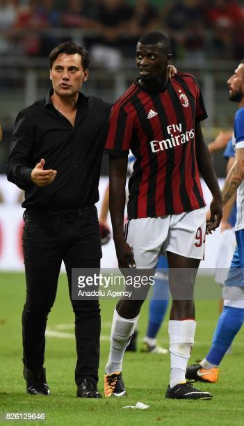 Head coach of AC Milan Vincenzo Montella speaks with M'Baye Niang during UEFA Europa League Qualifying Round match between AC Milan and CS U Craiova...