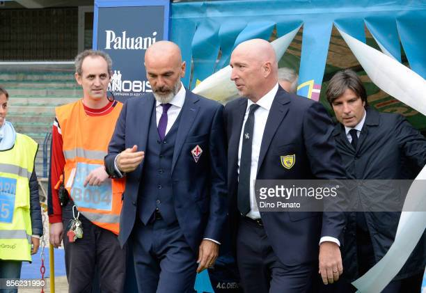 Head coach of ACF Fiorentina Stefano Pioli shakes hands with Head coach of ChievoVerona Rolando Maran during the Serie A match between AC Chievo...