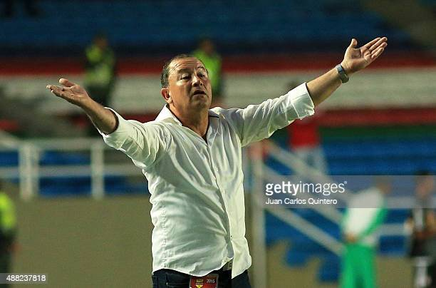 Head coach of America de Cali Alberto Suarez reacts during a match between America de Cali and Depor FC as part of 10th round of second leg of Torneo...