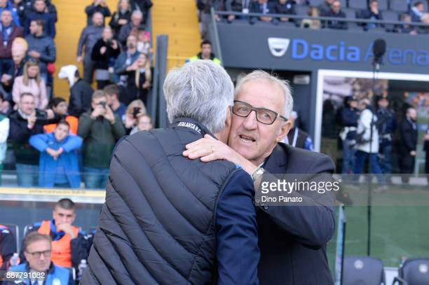 Head coach of Atalanta BC Gian Piero Gasperini shakes hands with Head coach of Udinese Luigi Delneri during the Serie A match between Udinese Calcio...