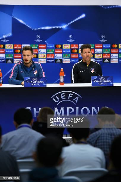Head Coach of Atletico Madrid Diego Simeone and player Saul Niguez hold a press conference ahead of UEFA Champions League Group C match between...