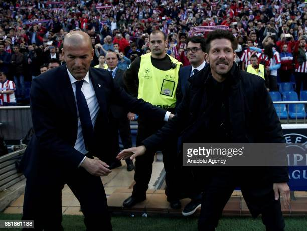 Head Coach of Atletico Madrid Diego Simeone shakes hands with Head Coach of Real Madrid Zinedine Zidane during the UEFA Champions League semi final...