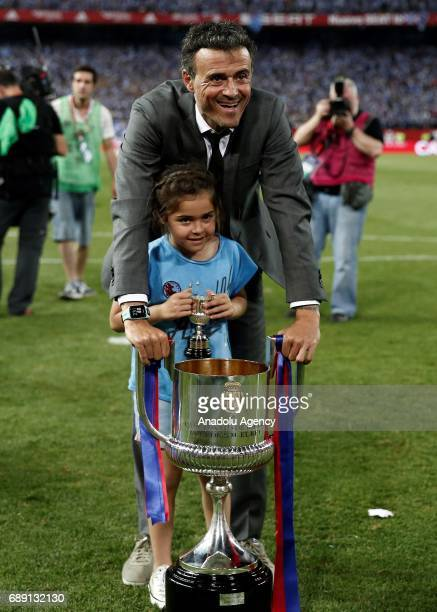 Head coach of Barcelona Luis Enrique celebrates with the trophy after the Copa Del Rey Final between FC Barcelona and Deportivo Alaves at Vicente...
