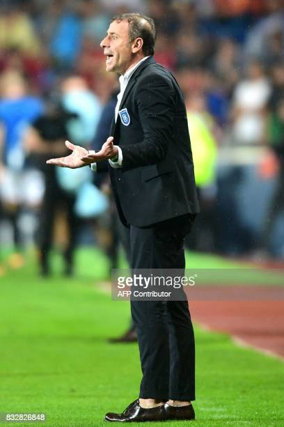 Head Coach of Basaksehir Abdullah Avci gestures to his players during the UEFA Champions League playoff first leg football match between Istanbul...