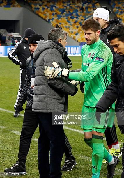 Head coach of Besiktas JK Senol Gunes consoles Fabricio of Besiktas JK after the UEFA Champions League football match between FC Dynamo Kiev and...