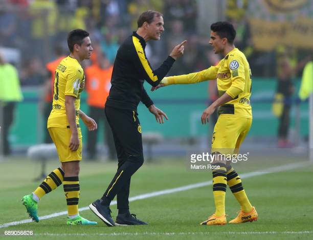 Head coach of Borussia Dortmund Thomas Tuchel talks to Marc Bartra of Dortmund during the DFB Cup final match between Eintracht Frankfurt and...