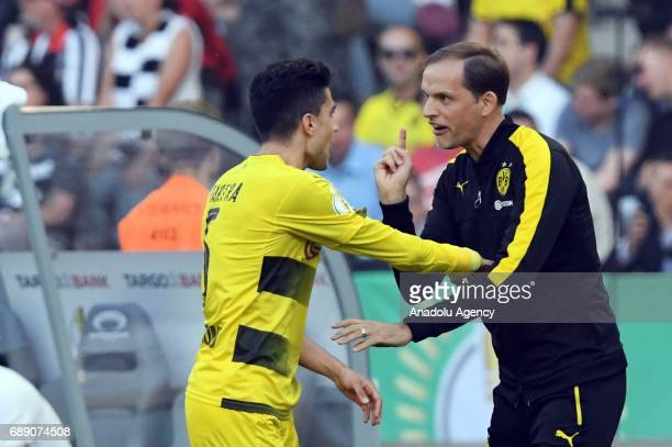 Head coach of Borussia Dortmund Thomas Tuchel talks with Marc Bartra during the DFB Cup Final 2017 soccer match between Eintracht Frankfurt and...