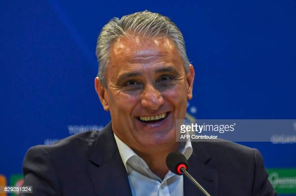 Head coach of Brazilian national football team Tite smiles during a press conference to announce the list of players for the upcoming Russia World...