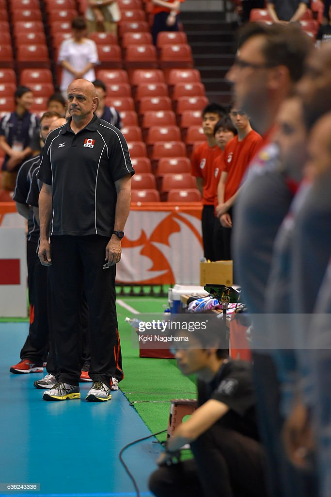 Head coach of Canada Glenn Hoag lines up for his national anthem prior to the Men's World Olympic Qualification game between Venezuela and Canada at Tokyo Metropolitan Gymnasium on June 1, 2016 in Tokyo, Japan.
