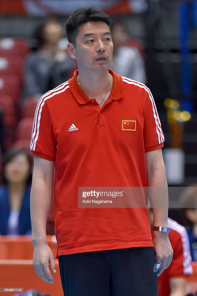 Head coach of China Xie Guochen looks on during the Men's World Olympic Qualification game between China and France at Tokyo Metropolitan Gymnasium on May 28, 2016 in Tokyo, Japan.