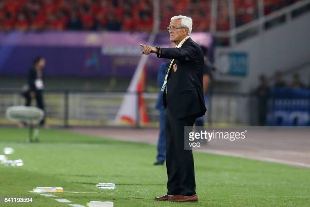 Head coach of Chinese national team Marcello Lippi looks on during the 2018 FIFA World Cup qualifier game between China and Uzbekistan at Wuhan...