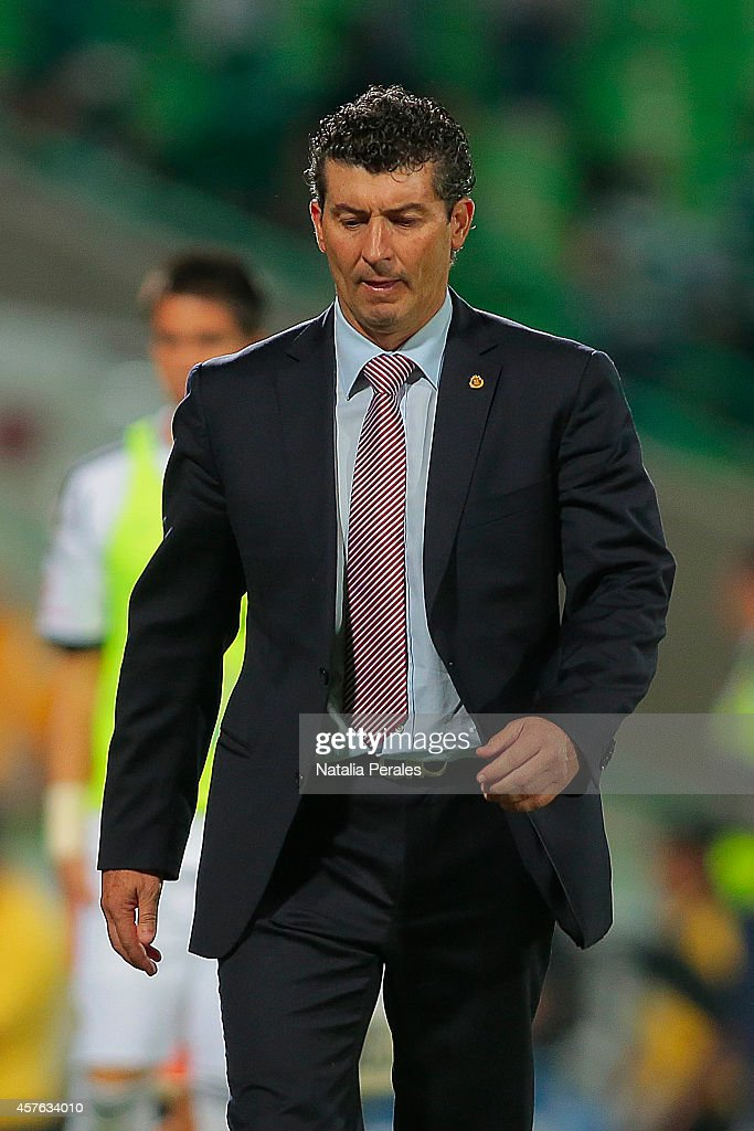 Head coach of Chivas <a gi-track='captionPersonalityLinkClicked' href=/galleries/search?phrase=Jose+Manuel+de+la+Torre&family=editorial&specificpeople=884919 ng-click='$event.stopPropagation()'>Jose Manuel de la Torre</a> leaves the field after a defeat during a Quarterfinals match between Santos Laguna and Chivas as part of Copa MX Apertura 2014 at Corona Stadium on October 21, 2014 in Torreon, Mexico.