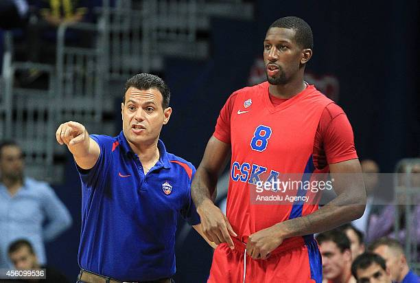 Head coach of CSKA Moscow Dimitris Itoudis speaks with Demetris Nichols during the International Gloria Cup match between Fenerbahce Ulker and CSKA...