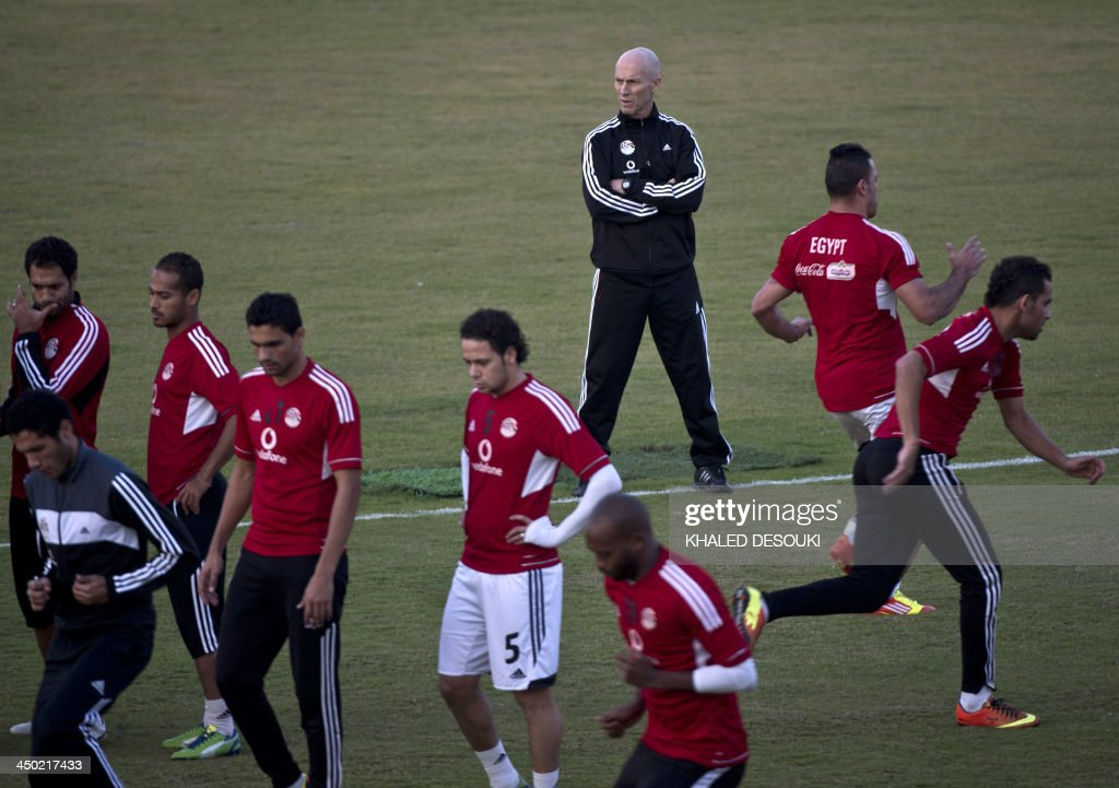 US head coach of Egypt's national football team Bob Bradli (3rd R), speaks to his players during a training session in Cairo on November 17, 2013 ahead of a return leg of a final World Cup play-off against Ghana. FIFA have ruled that Cairo is safe for a 2014 Africa Zone World Cup playoff between hosts Egypt and Ghana. Ghana had raised objections to Cairo hosting the match after the recent anti-government protests in Egypt.