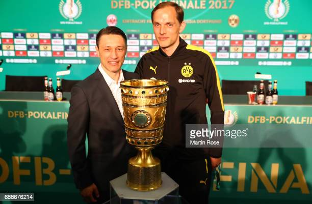 Head coach of Eintracht Frankfurt Niko Kovac and head coach of Borussia Dortmund Thomas Tuchel pose with the DFB Cup trophy after the DFB Cup Final...