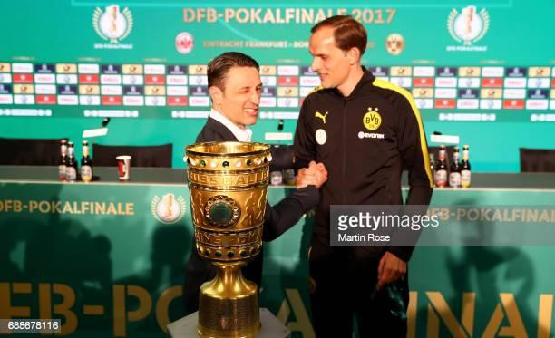 Head coach of Eintracht Frankfurt Niko Kovac and head coach of Borussia Dortmund Thomas Tuchel shake hands after the DFB Cup Final 2017 press...
