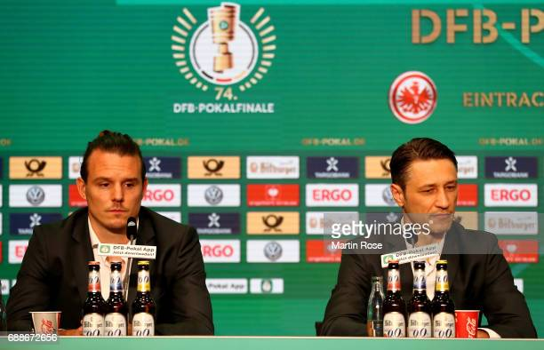 Head coach of Eintracht Frankfurt Niko Kovac and team captain of Eintracht Frankfurt Alexander Meier look on during the DFB Cup Final 2017 press...