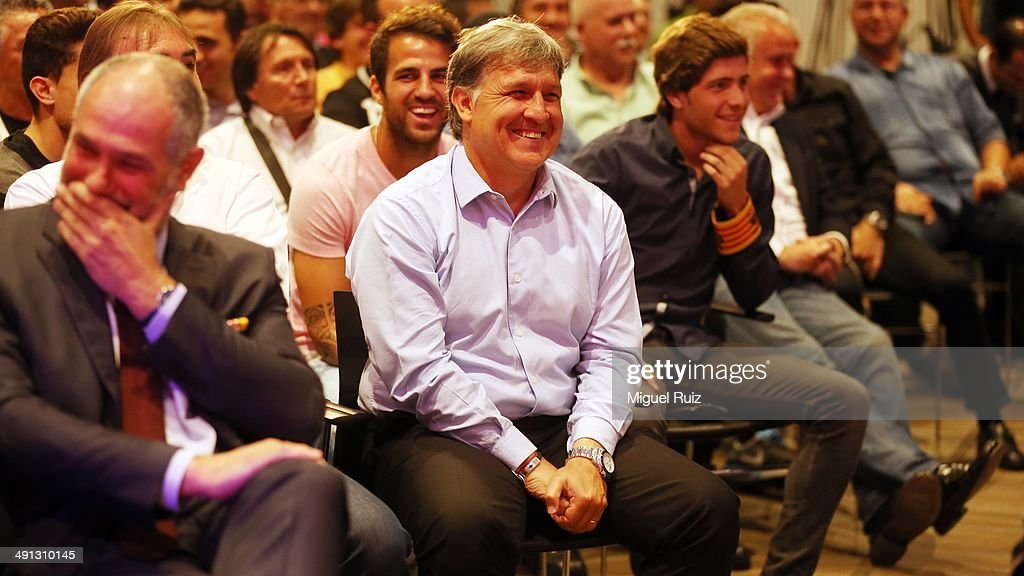 Head coach of FC Barcelona Gerardo Tata Martino (C) laughs during the farewell press conference as Puyol leaves FC Barcelona at the Auditorium 1899 on May 15, 2014 in Barcelona, Spain.