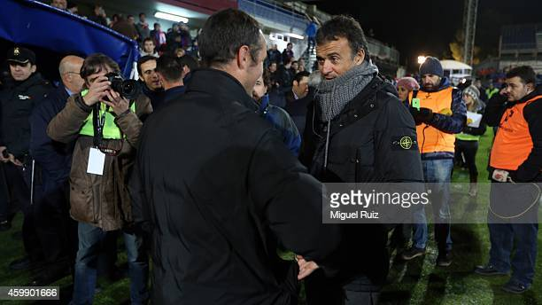 Head coach of FC Barcelona Luis Enrique greets the head coach of SD Huesca Luis Garcia Tevenet during the Copa del Rey 1/16 first leg match between...