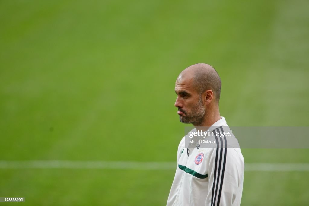 Head coach of FC Bayern Muenchen Josep Guardiola reacts during a training session ahead of their UEFA Super Cup final match against Chelsea FC at Stadion Eden on August 29, 2013 in Prague, Czech Republic.