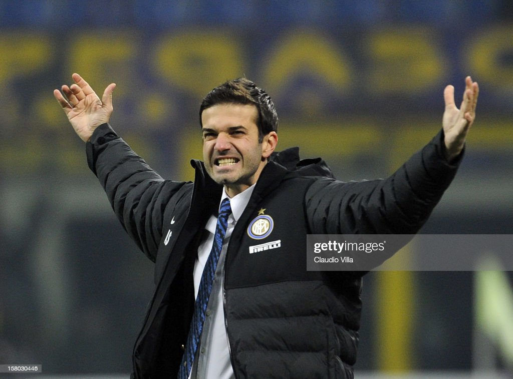 Head coach of FC Inter Milan Andrea Stramaccioni celebrates victory at the end of the Serie A match between FC Internazionale Milano and SSC Napoli at San Siro Stadium on December 9, 2012 in Milan, Italy.