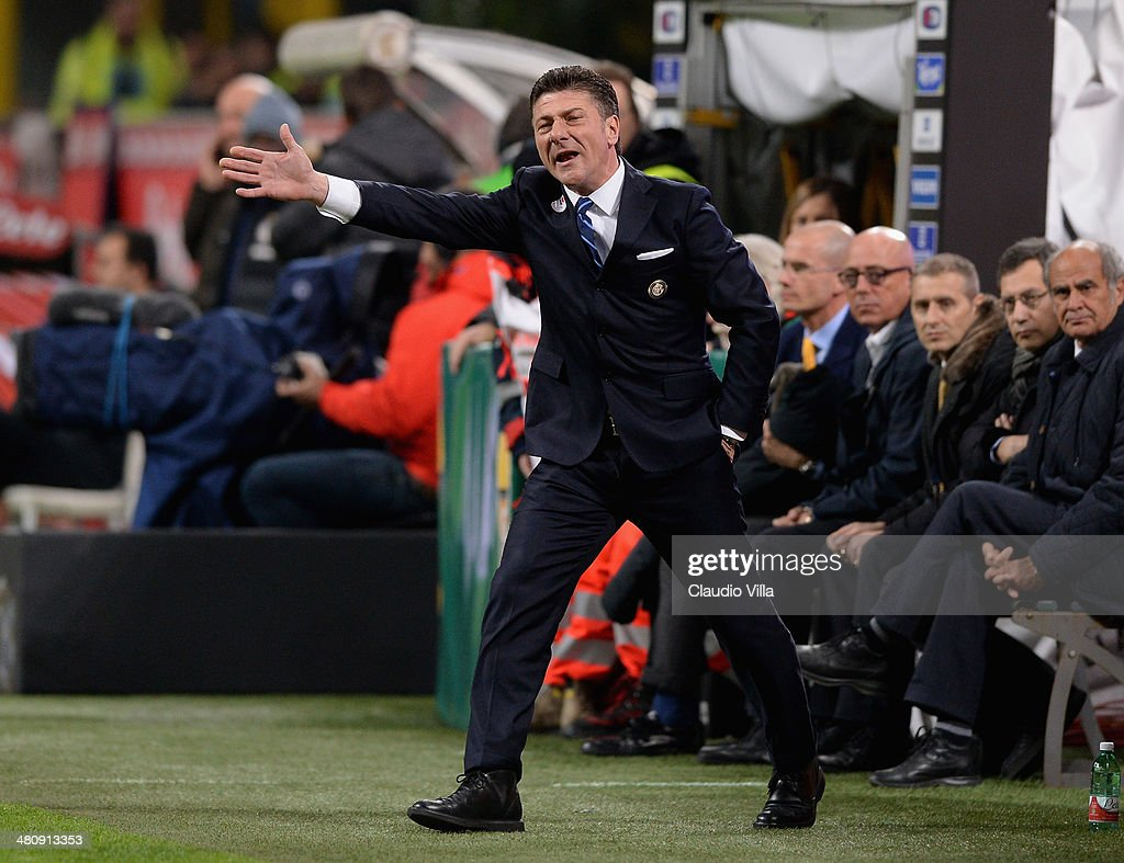 Head coach of FC Inter Milan <a gi-track='captionPersonalityLinkClicked' href=/galleries/search?phrase=Walter+Mazzarri&family=editorial&specificpeople=5314636 ng-click='$event.stopPropagation()'>Walter Mazzarri</a> reacts during the serie A match between FC Internazionale Milano and Udinese Calcio at San Siro Stadium on March 27, 2014 in Milan, Italy.