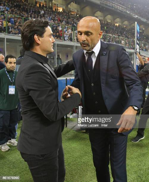 Head coach of FC Internazionale Luciano Spalletti shakes hands with head coach of AC Milan Vincenzo Montella before the Serie A match between FC...