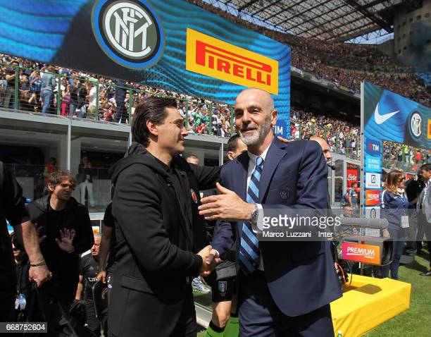 Head coach of FC Internazionale Stefano Pioli shakes hands with head coach of AC Milan Vincenzo Montella before the Serie A match between FC...