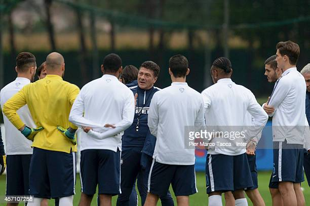Head Coach of FC Internazionale Walter Mazzarri speakes his teamplayer during the training session at Appiano Gentile on October 12 2014 in Como Italy