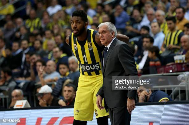 Head coach of Fenerbahce Dogus Zeljko Obradovic and Jason Thompson of Fenerbahce Dogus are seen during the Turkish Airlines Euroleague basketball...