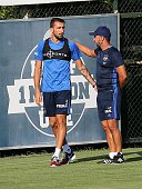 Head coach of Fenerbahce Vitor Pereira and Mehmet Topal talk each other during a training session prior to UEFA Champions League third preliminary...