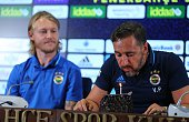Head coach of Fenerbahce Vitor Pereira blows out the candle to celebrate his birthday as he and Simon Kajer of Fenerbahce attend a press conference...