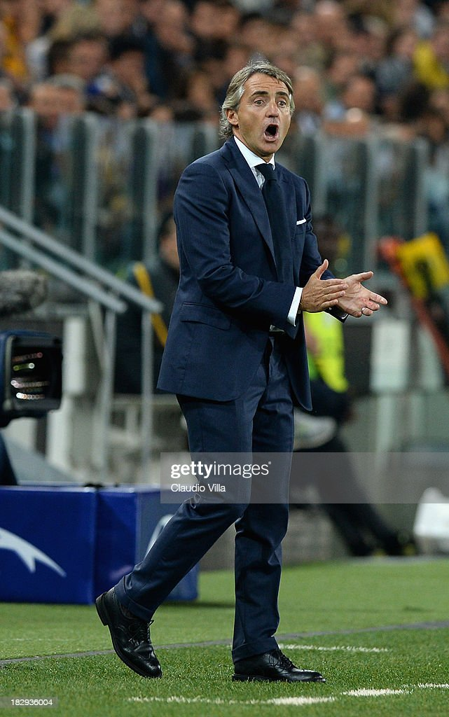Head coach of Galatasaray AS <a gi-track='captionPersonalityLinkClicked' href=/galleries/search?phrase=Roberto+Mancini&family=editorial&specificpeople=234429 ng-click='$event.stopPropagation()'>Roberto Mancini</a> reacts during UEFA Champions League Group B match between Juventus and Galatasaray AS at Juventus Arena on October 2, 2013 in Turin, Italy.