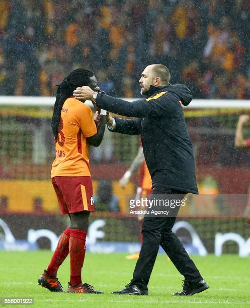 Head coach of Galatasaray Igor Tudor congratulates team's player Gomis after winning the Turkish Super Lig soccer match between Galatasaray and...