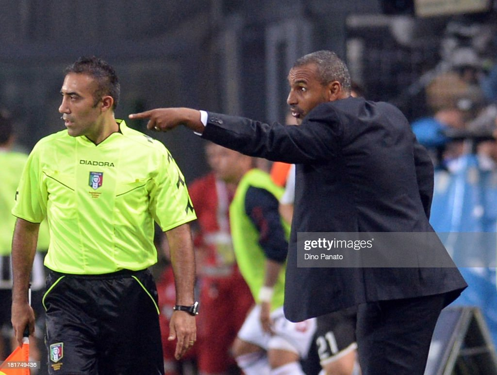 Head coach of Genoa CFC <a gi-track='captionPersonalityLinkClicked' href=/galleries/search?phrase=Fabio+Liverani&family=editorial&specificpeople=686043 ng-click='$event.stopPropagation()'>Fabio Liverani</a> gestures during the Serie A match between Udinese Calcio and Genoa CFC at Stadio Friuli on September 24, 2013 in Udine, Italy.